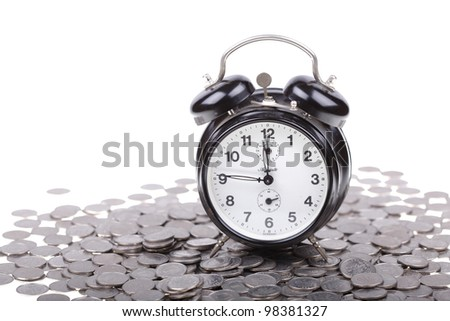 Old vintage clock on a money, coins. Polish zloty currency.