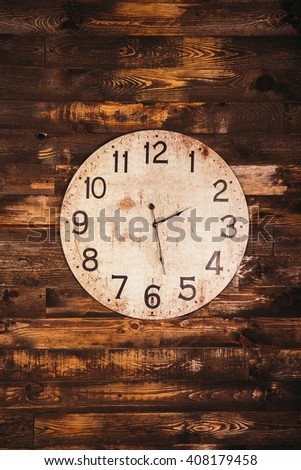 old vintage clock on a wooden wall - stock photo