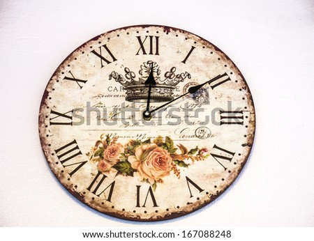 Old vintage clock on wall  - stock photo