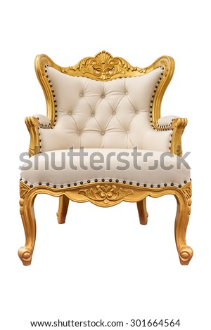 Old vintage cream leather classic armchair with gold color isolated on white background