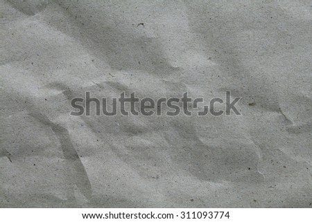 Old vintage creased paper isolated on black. - stock photo