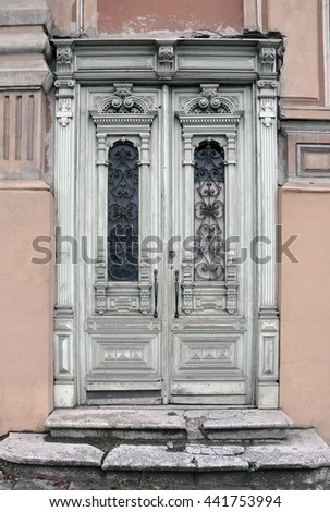 Old Vintage Door Of An Historic Building With Carved Wooden Decorations  Painted In White. Vilnius