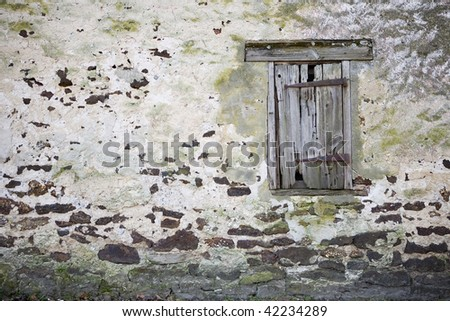 Old vintage farm house window with broken wall
