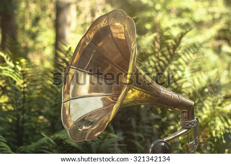 old vintage gramophone in a green garden  - stock photo