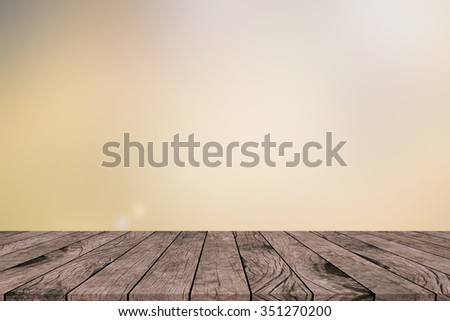 old vintage grungy red brown wood tabletop with blurred light tan sepia colored background with:grunge aged wooden paving with blurry light cream backdrop.show/advertising/promote products on display. - stock photo