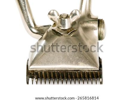 Old vintage hair trimmer, made from metal - stock photo
