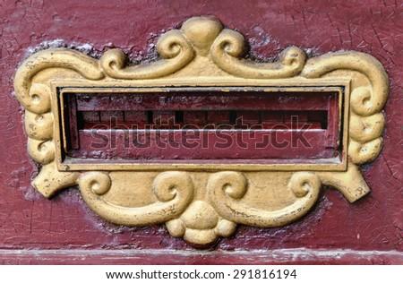 Old vintage horizontal photo of outgoing postal purple mailbox  - stock photo