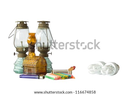 Old vintage lamps, matches, lighter, and electrical lamp isolated on white background. - stock photo
