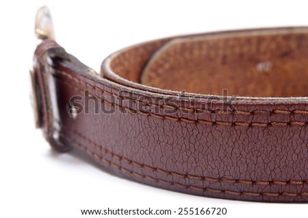 old vintage leather belt on white - stock photo