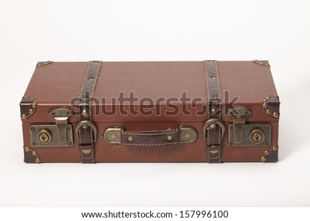 Old vintage leather suitcase lying down isolated on white - stock photo