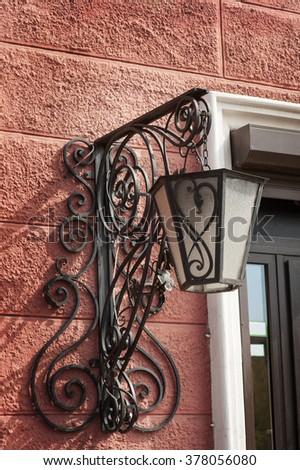 old Vintage metal lantern on street city. - stock photo