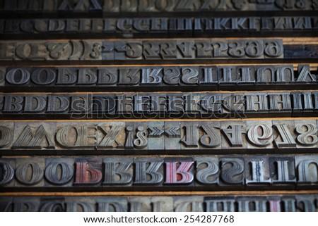 Old vintage metal printing press letters - stock photo