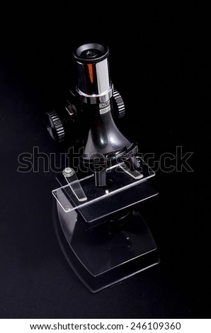 Old Vintage Microscope Isolated Over Black Background - stock photo