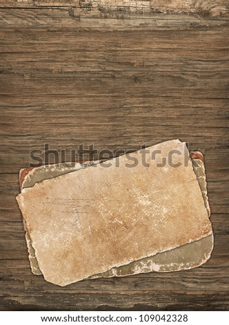 Old vintage papers on a wooden background