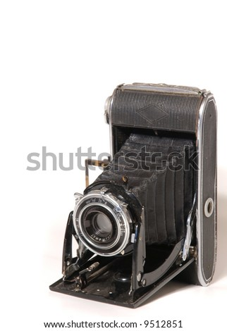 Old vintage photo camera isolated