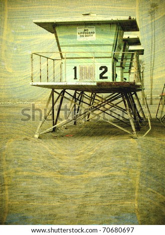 old vintage photo of lifeguard towers on beach - stock photo