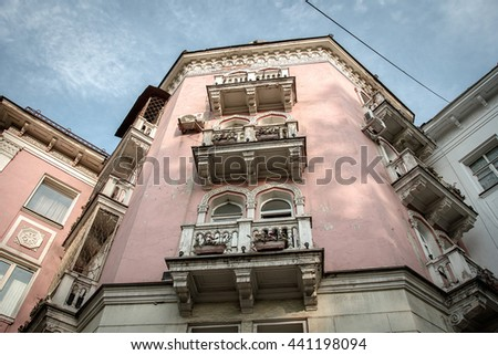 Old vintage retro building with balcony on the streets of Almaty, Kazakhstan. Bottom view - stock photo