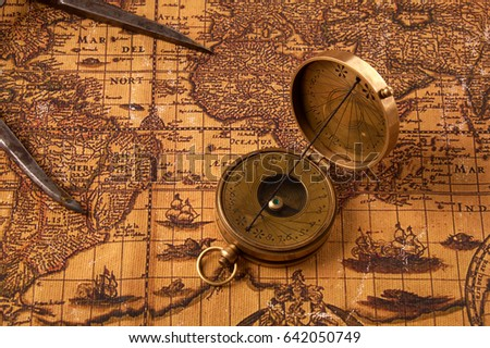 Old vintage retro compass on ancient stock photo safe to use old vintage retro compass on ancient world map vintage still life travel geography navigation gumiabroncs Image collections