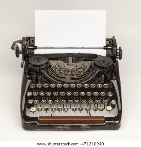 Old vintage russian typewriter and a blank sheet of paper inserted