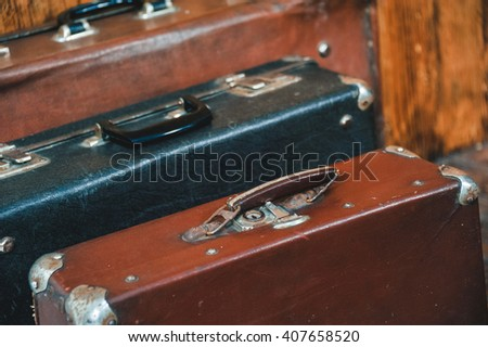 old Vintage Suitcase in the room with wooden floor - stock photo