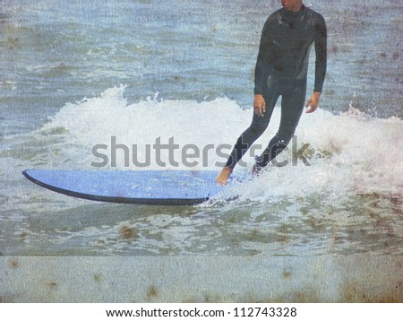 old vintage surf background with rider - stock photo