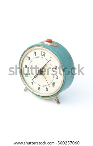 Old vintage table clock isolated