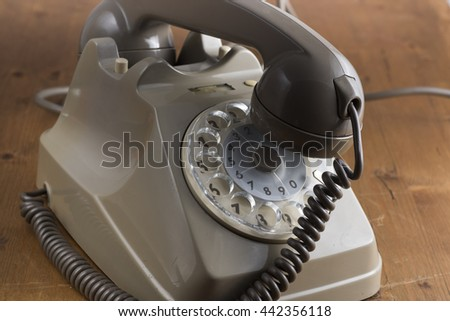 old vintage telephone on the wooden table. old style - stock photo
