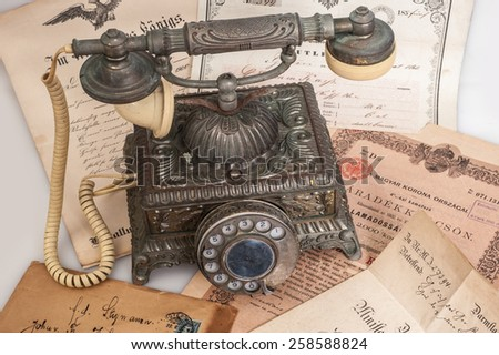 old vintage  telephone  with ancient letters - stock photo