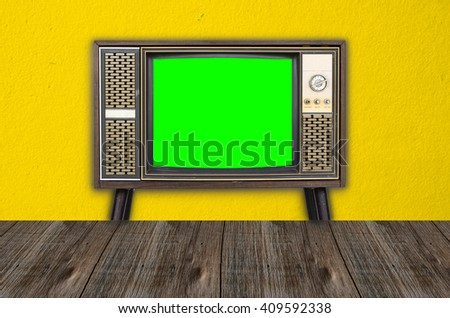 Old vintage television on yellow background - stock photo