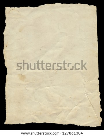 Old vintage torn creased paper isolated on black.