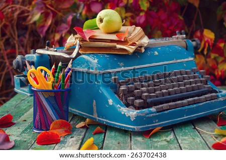 Old vintage typewriter on wooden table. Selective focus. Toned images.  - stock photo