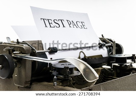Old vintage typewriter with blank paper sheet, isolated on white background - stock photo
