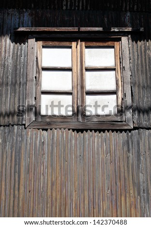 Old vintage window and rusty corrugated wall - stock photo