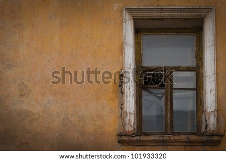 old vintage window on old yellow wall Vintage city background - stock photo