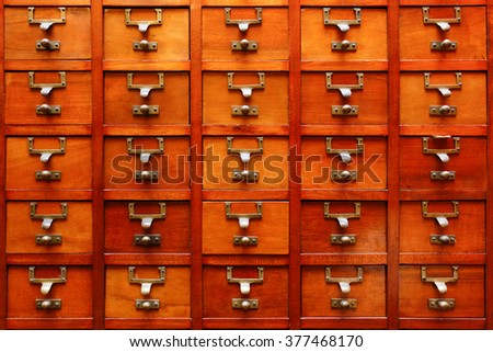 Old Vintage wood drawer organizer, with great color and details. - stock photo