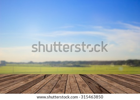old vintage wooden desk table with blurred nature backgrounds , put and show your products on this backgrounds - stock photo