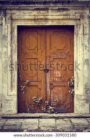 Old vintage wooden door. Grunge style building