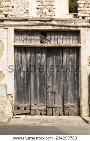 old vintage wooden door in a house on the island of Sardinia, Italy