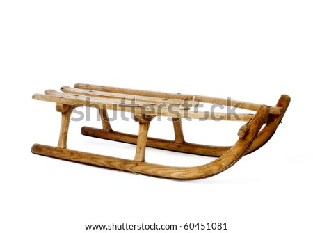 Old vintage wooden sled on white