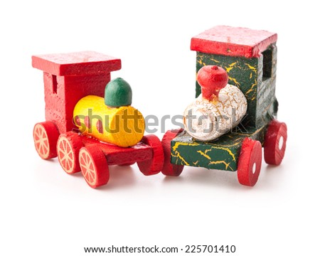 Old vintage wooden toy train on white background  - stock photo