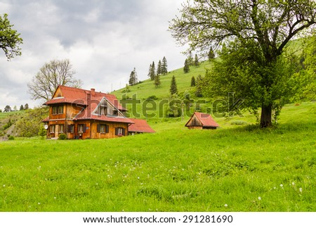 Old vintage, wooden traditional house in the mountains in Pieniny mountains, Poland - stock photo