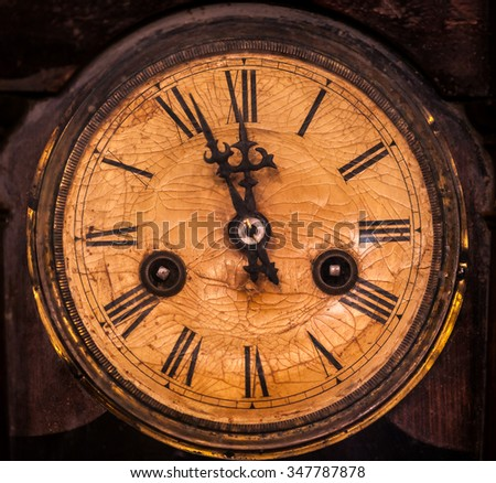 Old vintage wooden wall clock hanging on wall - stock photo