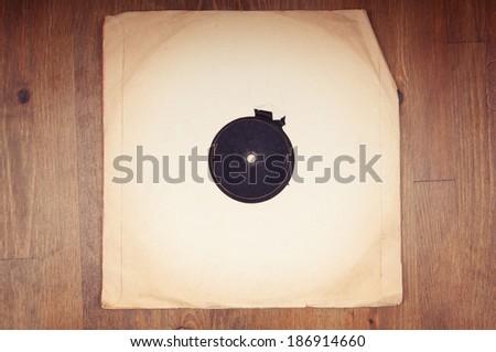 Old vinyl record in paper envelope closeup - stock photo