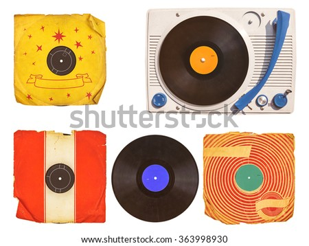 Old vinyl turntable player with record albums isolated on white - stock photo