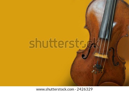 old violin on a yellow background