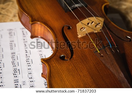old violin with score - stock photo