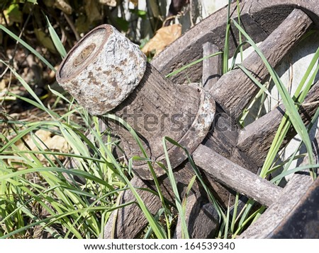 old wagon wheel and grass