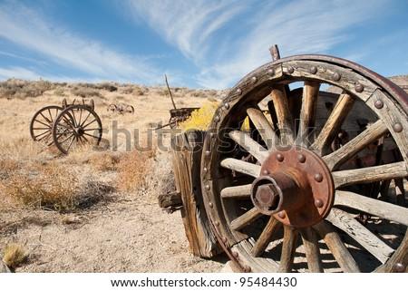 Old Wagon Wheel in the California Desert - stock photo
