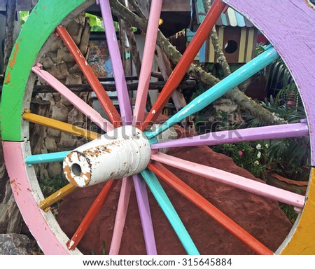Old wagon wheel is colorfull - stock photo