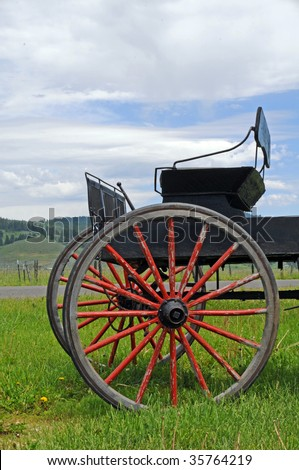 old wagon with red wheels & buggy seat